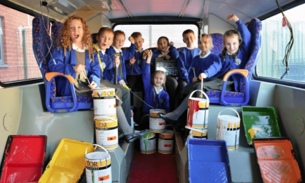 Pupils help give old bus a makeover as new library takes shape