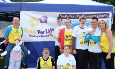 Youngsters with disabilities tackle the world's biggest obstacle course to raise funds for charity