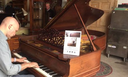 Vintage piano raises a grand sum for St Oswald's