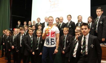 Olympic rower offers golden advice to pupils at former school