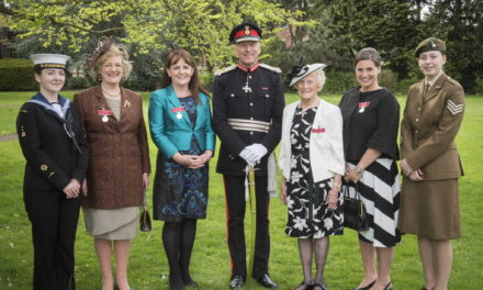 British Empire Medals recipients are presented with their awards