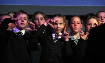 Students and staff perform in concert for Africa