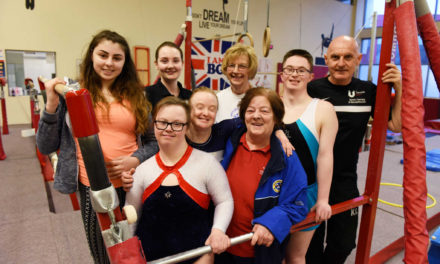 Students help gymnasts with Special Olympics preparation