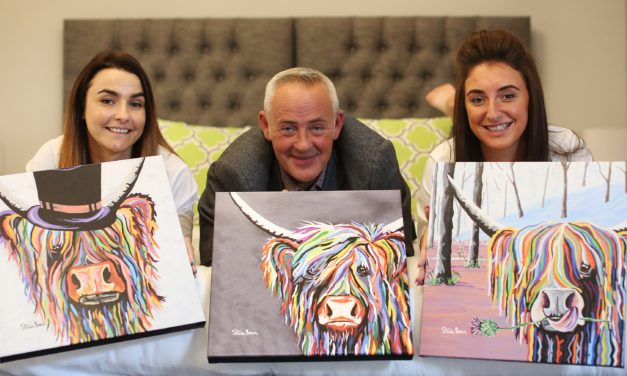 Cow artist over moon with hotel display