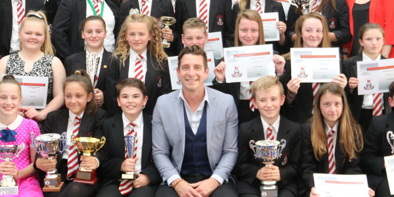 Top swimmer urges students to take the plunge