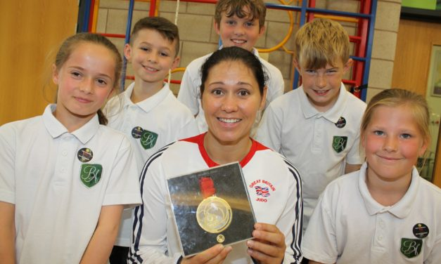 Judo gold medalist puts students through their paces