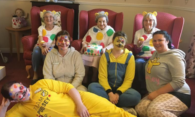 Elderly paint and don Pudsey shirts for Children in Need