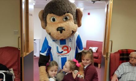 H'Angus surprises pupils during care home trip