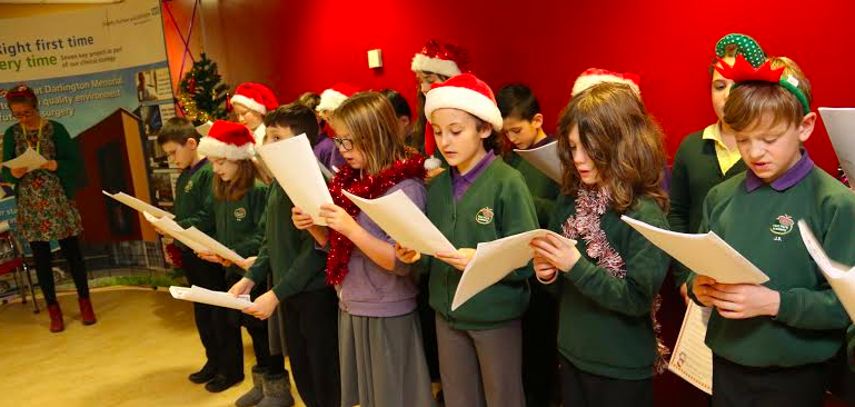 Pupils Sing for Doctors and Nurses