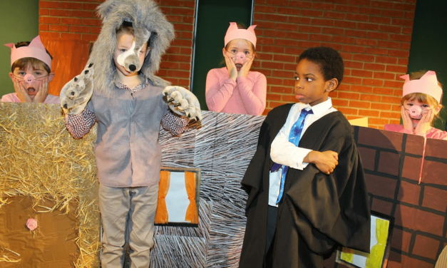 Pupils perform three pigs with a twist