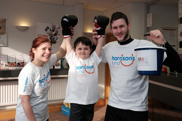 Building society team work their muscles for wasting disease charity