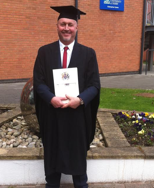 Neil Swaps Hard Hat for Mortarboard at Diploma Graduation Ceremony