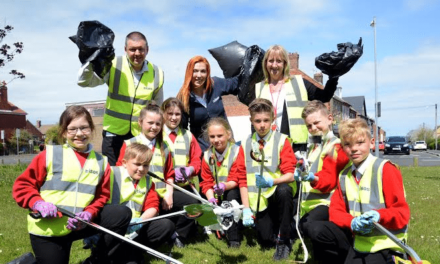 Children pitch in to clean up their community