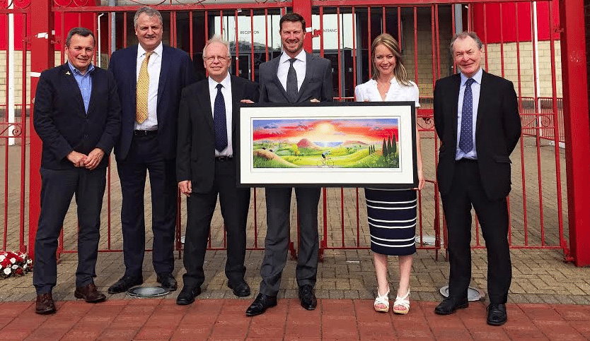Tour de Yorkshire artist and daughter of football legend Willie Maddren donates picture to father's former club