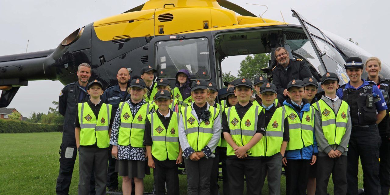 Force helicopter drops in to reward mini police