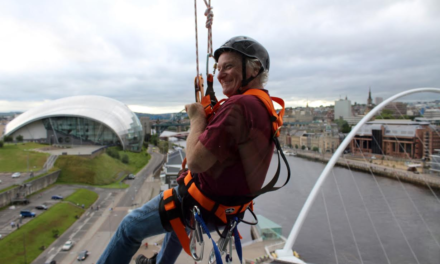 Lindisfarne singer abseils for cancer charity