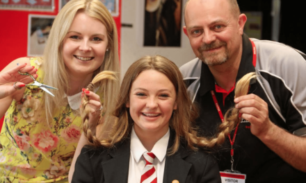 Student Shaves Hair for Charity