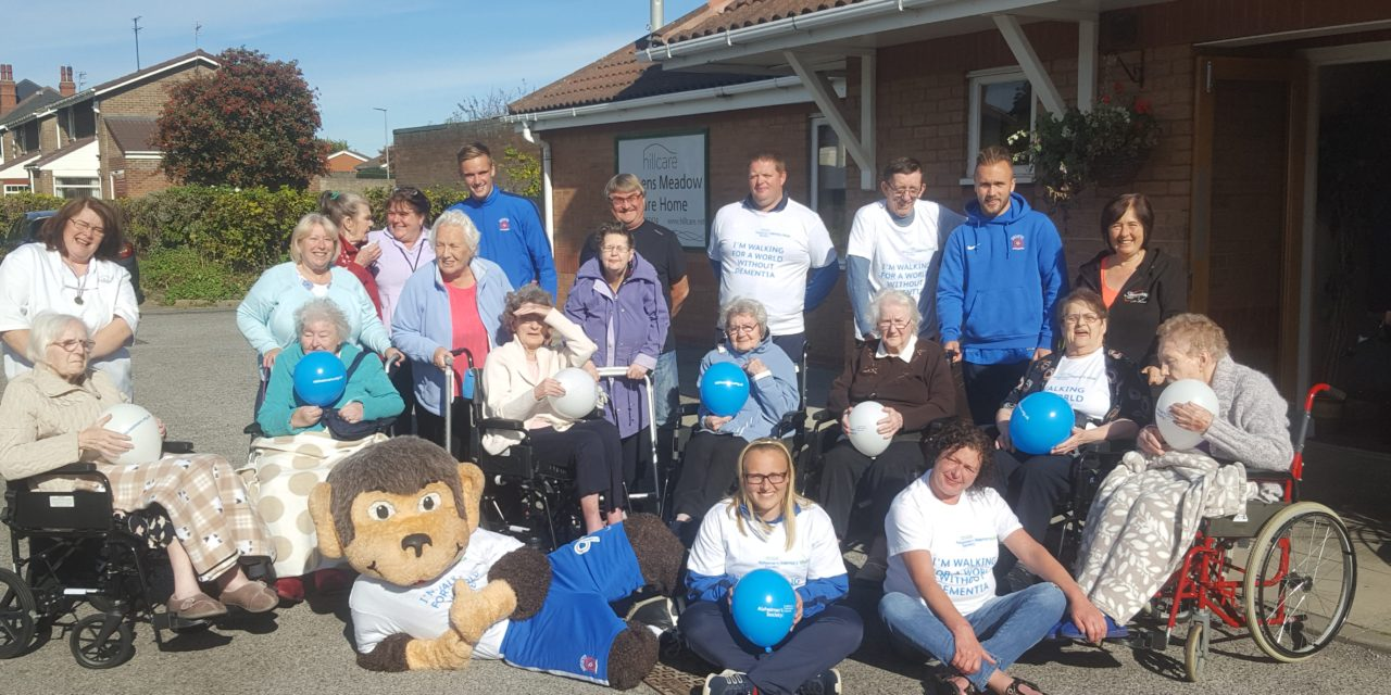 Footballers join elderly for Alzheimer's Memory Walk