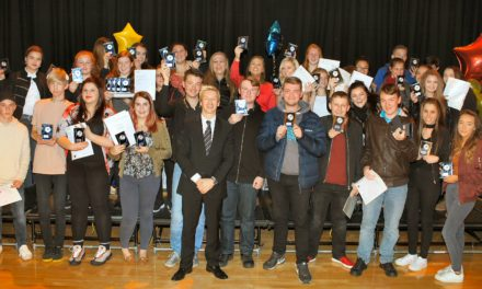 Top gymnasts helps students celebrate success