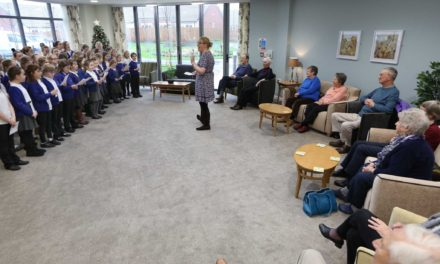 Young carol singers visit new Sowerby extra care facility