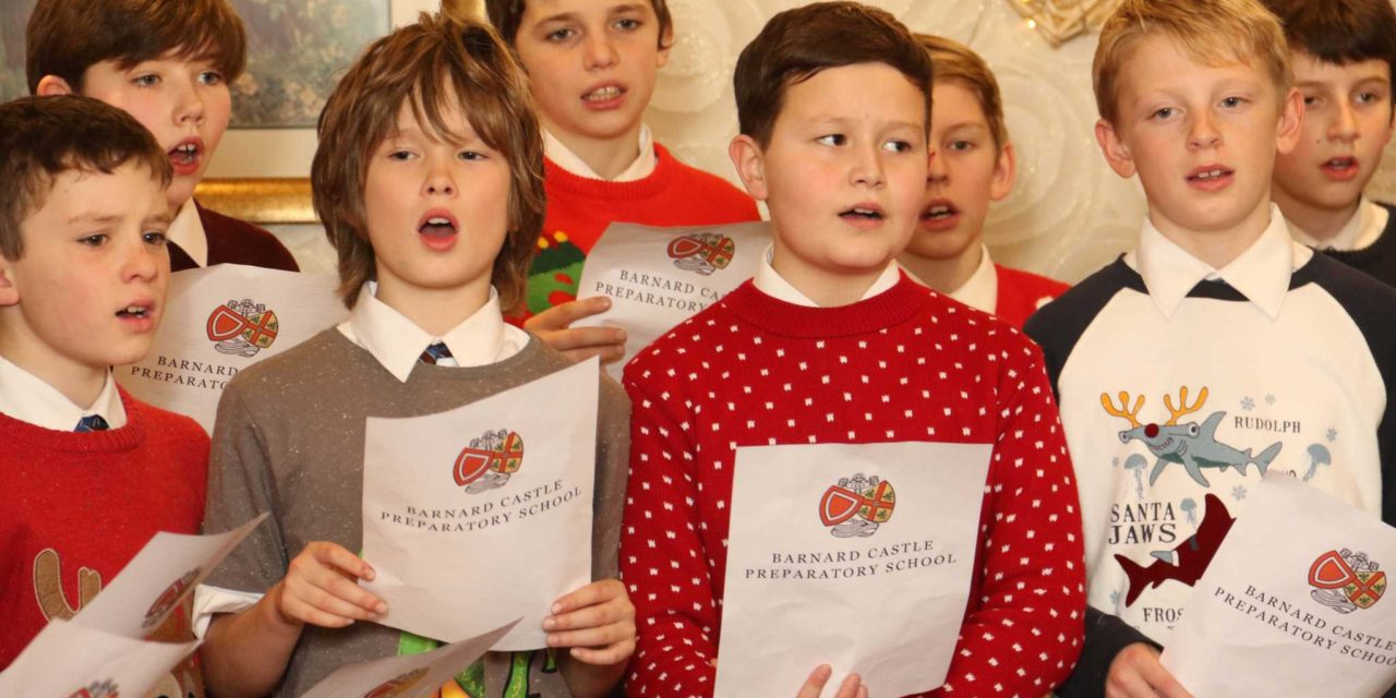 Pupils bring Christmas cheer to town's elderly citizens