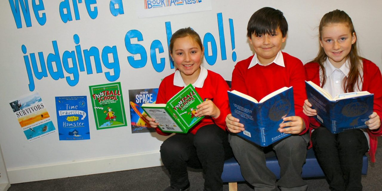 Young book judges awarded Blue Peter badge