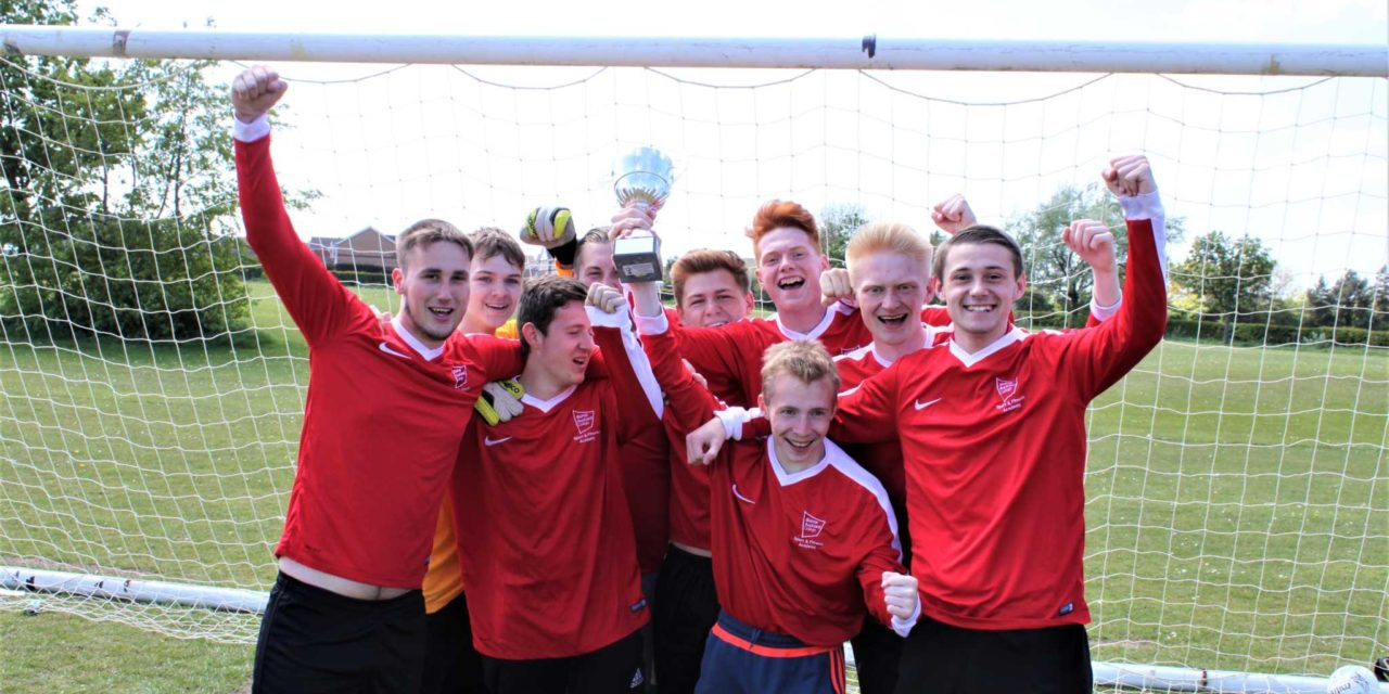 Football team celebrates winning Colleges' League title