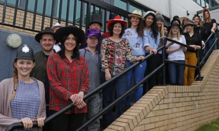 Lawyers sport hats for brain injury charity