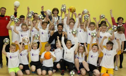 Boro star scores with school pupils