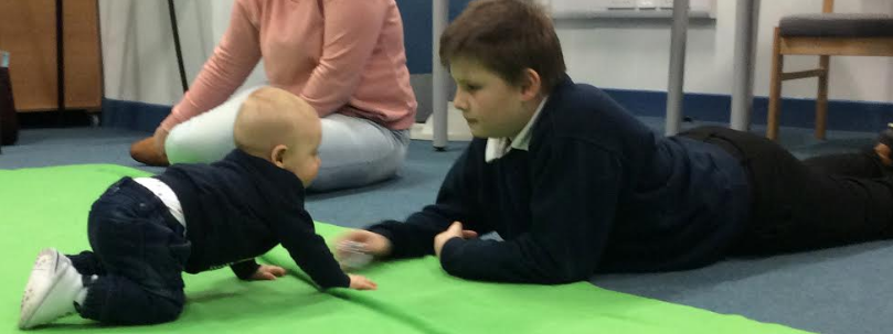 Bringing up baby helps children learn to communicate