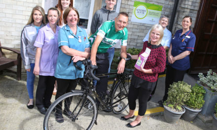 Thirsk care home welcomes local cycling hero to celebrate fundraising success