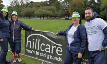 Runners get greened at Hill Care gate in Colour Run