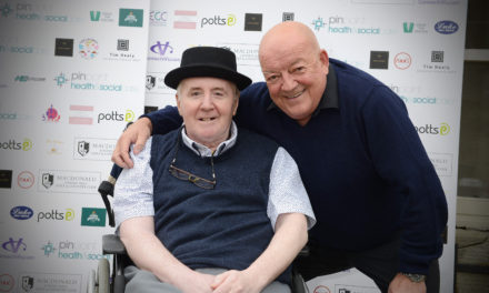Tim puts a smile on pal at golf day