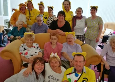 Care home's onesies and cakes raise Children in Need funds
