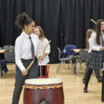 Students bang the drum for Japanese culture