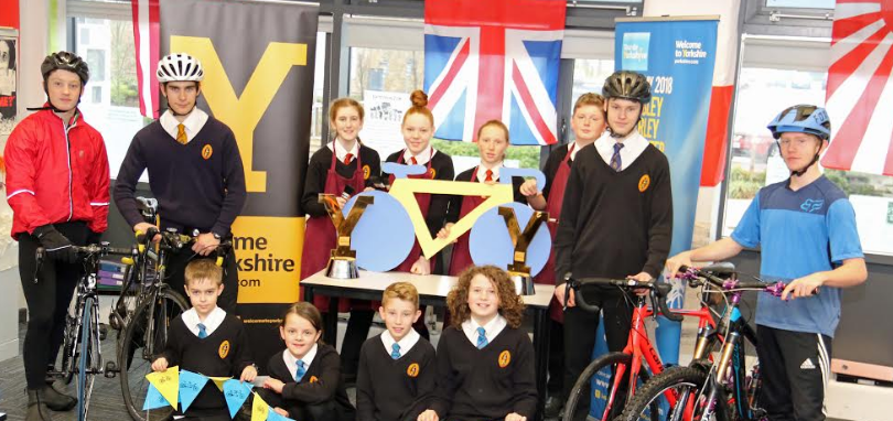 Students get a tantalising taste of Tour de Yorkshire trophies