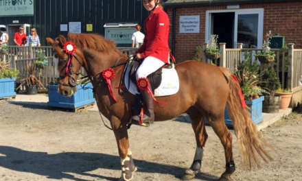 Newly formed equestrian team jumps for joy at opening success