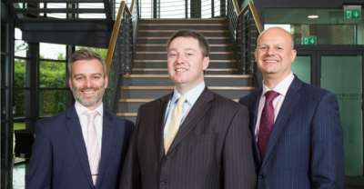The team at Novus Wealth Management celebrates a successful year end (L-R) Nick Braun%2c Jon Sturrock and Ben Danson cropped