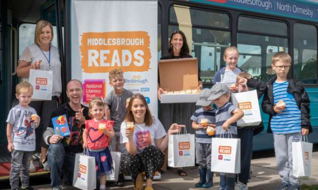Children hop on board the Middlesbrough Reads literacy bus and pick up free books in celebration of the campaign's 5th anniversary