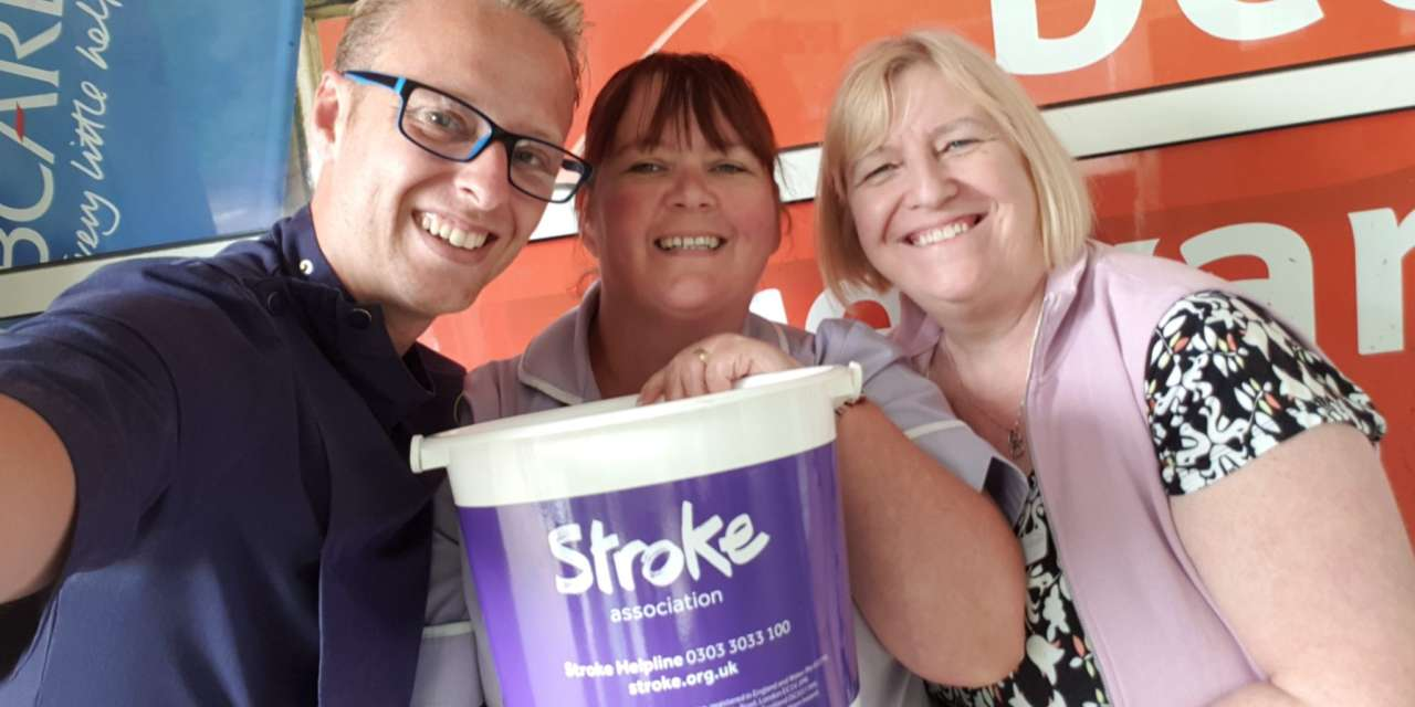 Care home staff pack shopping bags for Stroke Association