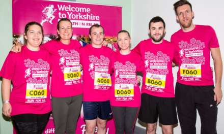 Accounting firm swaps calculators for trainers for charity marathon relay