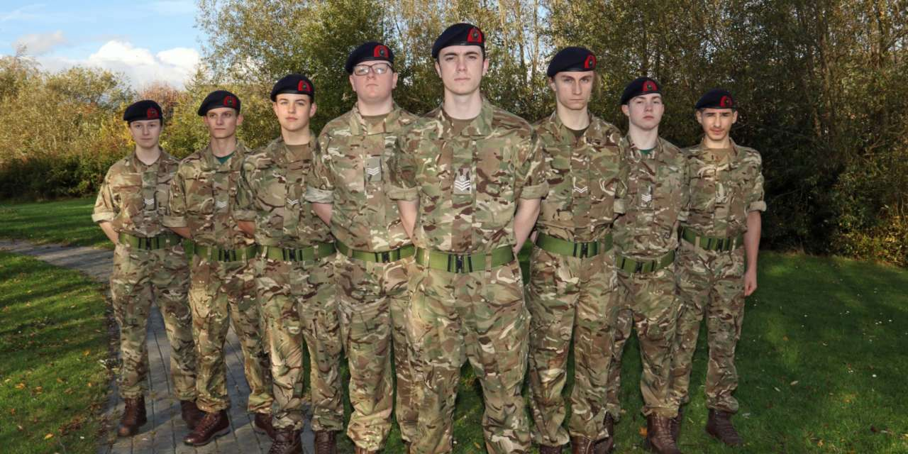 Officers at academy cadet force on parade at sixth form open evening