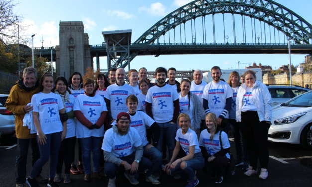 Daredevil RG staff raise £8,000 for St Oswald's Hospice