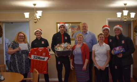 Boro U23s deliver Christmas gifts to elderly