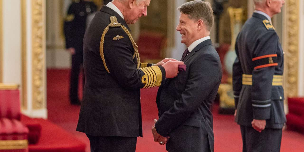 PSYCHE OWNER STEVE TALKS MIDDLESBROUGH AND FASHION WITH PRINCE CHARLES AS HE RECEIVES AN MBE