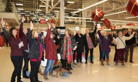 Fund-raising in a flash as hospice choir entertains shoppers