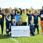 Goal! Five star housebuilder meets football club's appeal for kit sponsorship