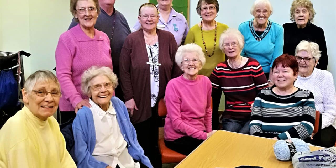 Knitted walking frame bags bring joy to care home residents