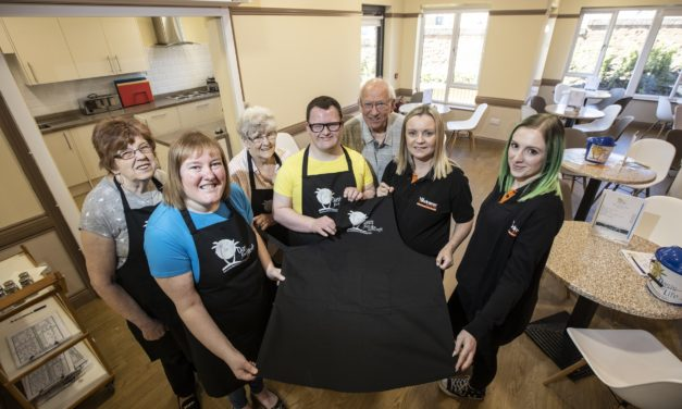 Workwear donation gives charity community café workers a confidence boost ahead of opening
