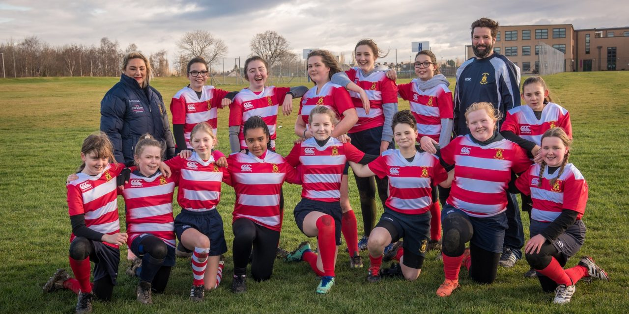 Grassroots girls' rugby team team kitted out thanks to Venator Together Fund